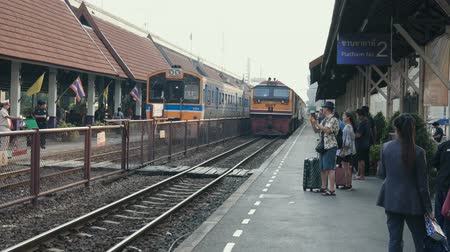 departing : BANGKOK - JANUARY 10, 2019: The train arrives at the Don Mueang station in Bangkok, Thailand. Stock Footage