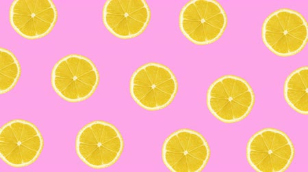 c vitamini : Minimal motion design animation. Lemons wiggle color background. Abstract graphics in trendy colors and style. Seamless looping animation.