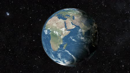 sztratoszféra : Planet earth from space. Realistic world globe spinning slowly animation. Camera over Indian Ocean and Africa. Stock mozgókép