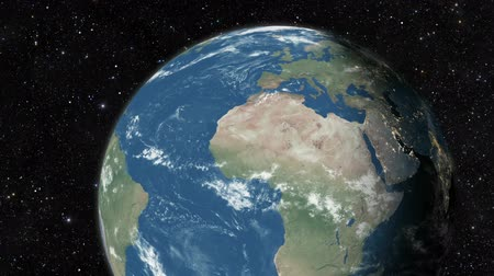 Észak amerika : Planet earth from space. Realistic world globe spinning slowly animation. Camera over Indian Ocean, Africa, Central America.