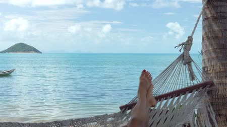 гамак : Woman lying in a hammock on the beach