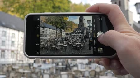 Taking photo of the street cafe in Monschau, Germany