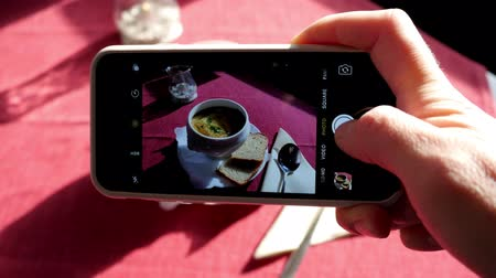 Woman taking picture of the french onion soup Stock mozgókép