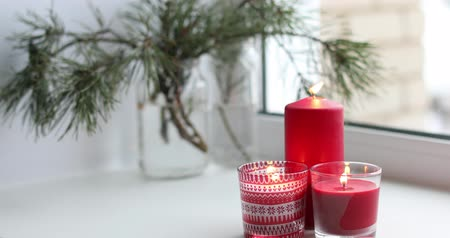 Candles on a windowsill. Christmas time