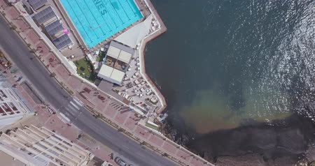 Мальта : Aerial view on the Spinola Bay with outside pool in St.Julians from above - St.Julians, Malta Стоковые видеозаписи