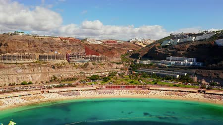 kanarya : Beautiful aerial view of the full Playa de Amadores bay beach on Gran Canaria island in Spain. Stok Video