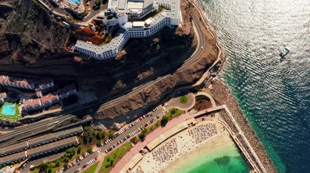 çare : Beautiful aerial view of the full Playa de Amadores bay beach on Gran Canaria island in Spain. Stok Video
