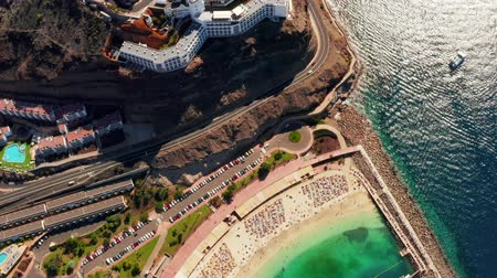 Beautiful aerial view of the full Playa de Amadores bay beach on Gran Canaria island in Spain. Стоковые видеозаписи