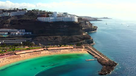 beach panorama : Beautiful aerial view of the full Playa de Amadores bay beach on Gran Canaria island in Spain. Stock Footage