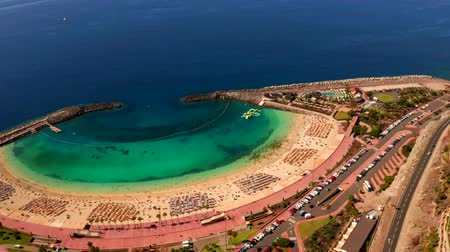 Beautiful aerial view of the full Playa de Amadores bay beach on Gran Canaria island in Spain. Stok Video