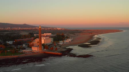 kanarya : Aerial lighthouse view in Meloneras district on Gran Canaria island during magical sunset near Maspalomas dunes.