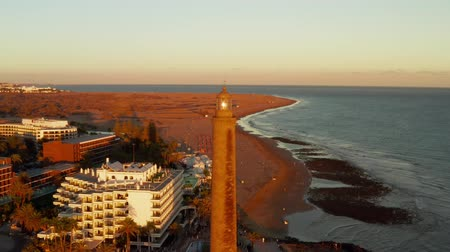 Aerial lighthouse view in Meloneras district on Gran Canaria island during magical sunset near Maspalomas dunes.