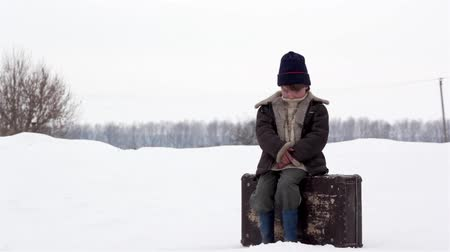 evsiz : boy with a suitcase in winter