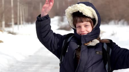 goes : winter village boy goes to school-portrait  Stock Footage