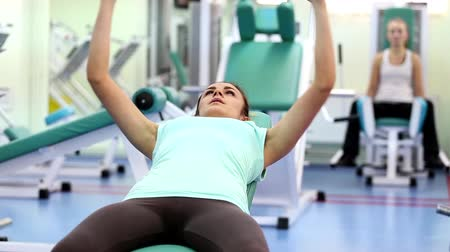 ćwiczenia : Gym work out young women,Young  beauty woman exercising at a gym Wideo