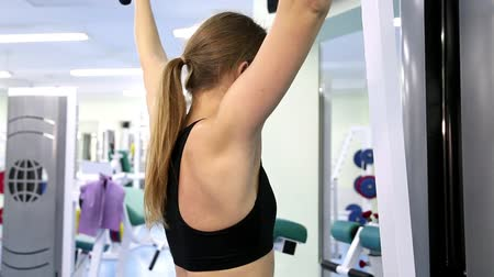 sport : Gym work out young women,Young  beauty woman exercising at a gym (side view)