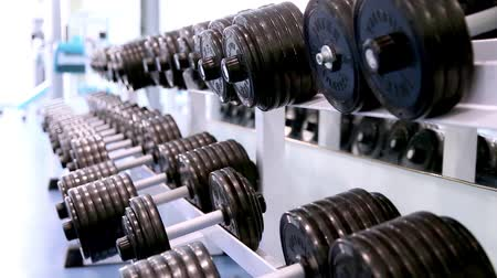sport : man at the gym,hand takes the dumbbell
