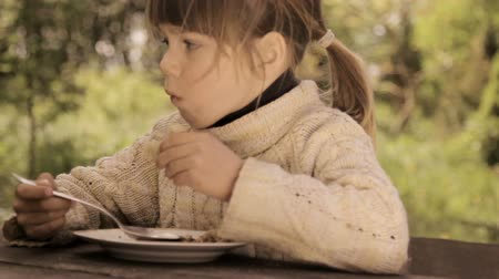 spoons : Child eats porridge spoon.Appetizing girl eats porridge Stock Footage