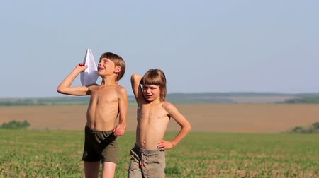 paper airplane : Boys launch a paper airplane.Children playing with a paper airplane. Stock Footage