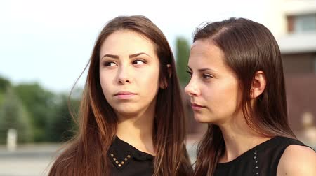 pletyka : Young girlfriends have fun gossiping.Young students talking emotionally.Portrait of young girls sisters.