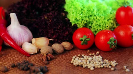 warzywa : Composition of fresh vegetables and spices. Fresh vegetables and spices close up. Still life of vegetables and spices for advertising. Fresh food shot in studio. Wideo