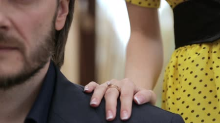 sentimentos : Portrait of a man and a girls hand. Woman lays down his hand on the mans shoulder. Men face close-up and a female hand. Concept of love, relationships, feelings. Stock Footage