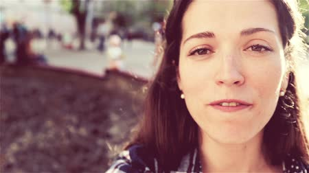 passerby : Speech by a European teacher of English on the benefits of development. Beautiful young teacher speaks at the camera, video with sound. Stock Footage