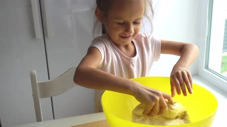cheese slices : A little girl kneads dough for pizza. Dough 4k video. Stock Footage