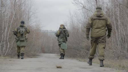 войска : A group of scout saboteurs perform the task. An armed soldier, terrorist, saboteur.