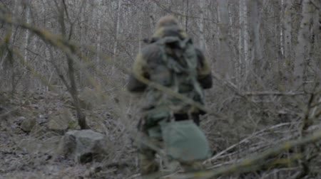 terrorizmus : A group of scout saboteurs perform the task. An armed soldier, terrorist, saboteur.