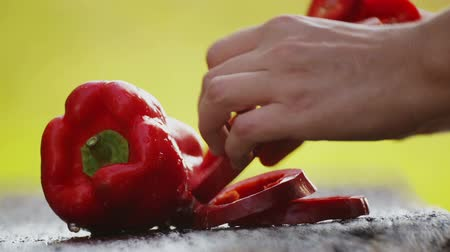 hot peppers : A boy eats an apple and considers fresh vegetables. Teenage boy with a box of harvested fresh natural vegetables. Stock Footage
