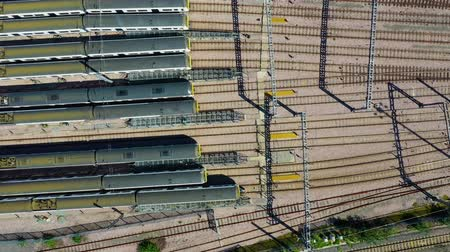 Aerial view over passenger trains in rows at a station Vídeos