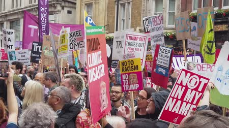 direitos : LONDON, UK - June 4th 2019: Large crowds of protesters gather in central London to demonstrate against President Trumps state visit to the UK