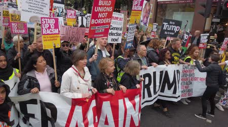 vélemény : LONDON, UK - June 4th 2019: Large crowds of protesters gather in central London to demonstrate against President Trumps state visit to the UK