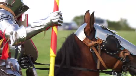armoured : Brackley, UK - June 7th 2019: A medieval knight on horseback takes part in a jousting competition Stock Footage