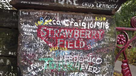 bretanha : Liverpool, UK - October 31 2019: Iconic red gateway to Strawberry fields in Liverpool. Made famous by The Beatles song Strawberry fields forever. Vídeos