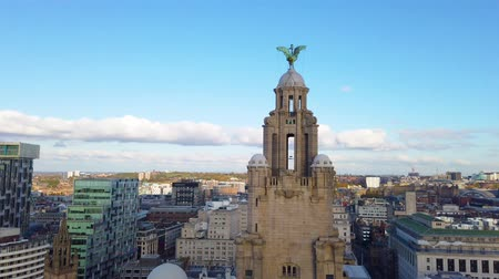 Liverpool, UK - October 30 2019: High aerial view of the Royal Liver Building and Liverpool City skyline