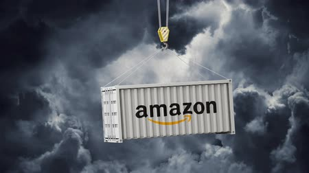 retailer : LONDON, UK - January 30th 2020: amazon logo on a swinging shipping container Stock Footage