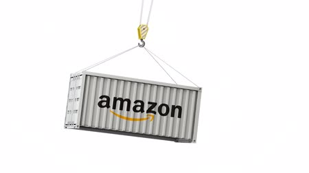 szemléltető : LONDON, UK - January 30th 2020: amazon logo on a swinging shipping container Stock mozgókép
