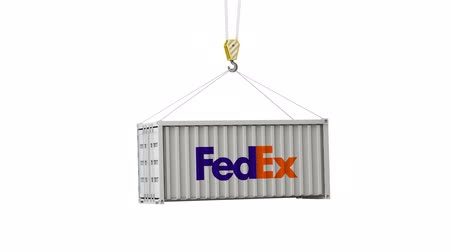 отправка : LONDON, UK - February 4th 2020: FedEx logo on a swinging shipping container Стоковые видеозаписи
