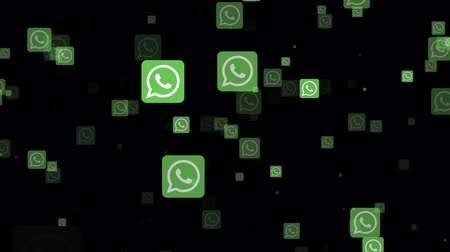 общаться : LONDON, UK - February 26th 2019: Whatsapp socialmedia logo fly through animation
