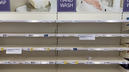 bakkaliye : OXFORD, UK - March 16th 2020: Empty supermarket shelves at a local grocery store as people prepare for coronavirus lockdown Stok Video