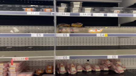 stockpile : OXFORD, UK - March 16th 2020: Empty supermarket shelves at a local grocery store as people prepare for coronavirus lockdown Stock Footage