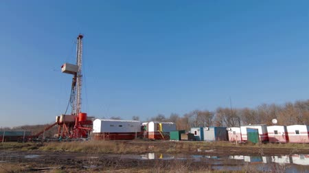 exploration : Oil drilling rig in field after rain