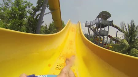 slayt : POV Fun on the water slide in aqua park