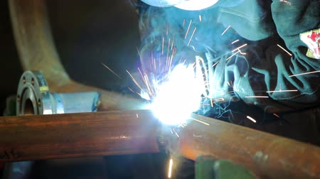 fire facilities : Welder at work in factory Stock Footage