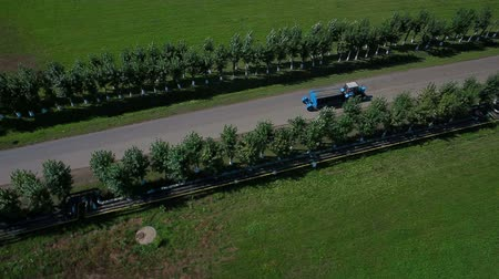 eighteen : Aerial view a tractor driving on road Stock Footage