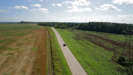 honit : Aerial view car driving on country road Dostupné videozáznamy