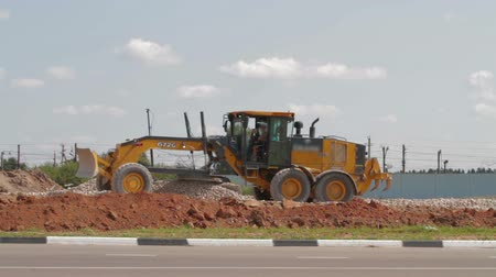 curbside : Loader excavator at road construction work