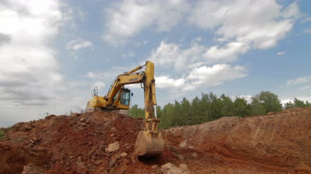 dredging : Russia, Moscow - 2016: Excavator Scooping and Dumping on Dirt Pile
